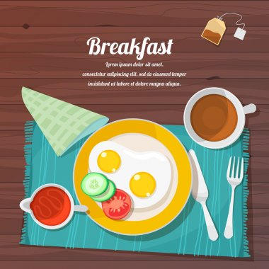 Breakfast table with scrambled eggs, toast and fresh vegetables