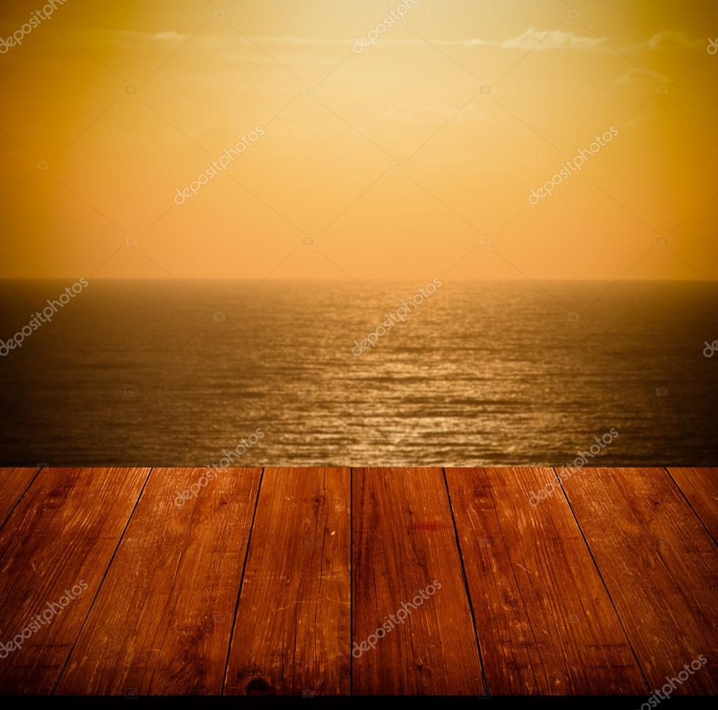 Beautiful view of the Mediterranean Sea over old dark wooden tab