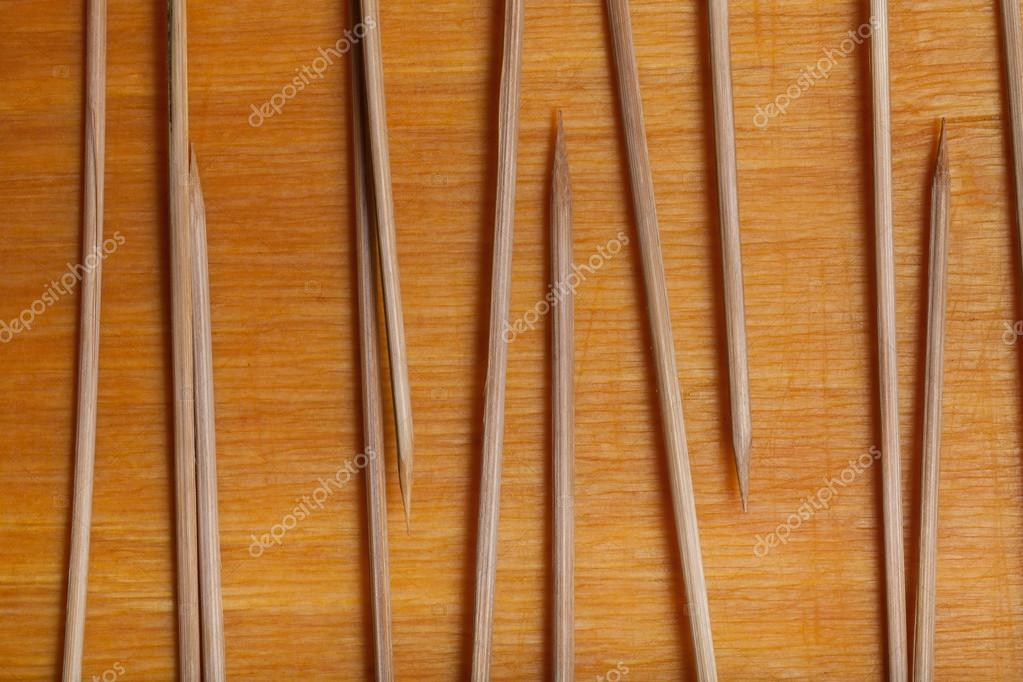 Sticks For The Gingerbread Cookie On The Old Wooden Cutting Boar