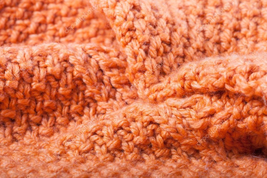 190731b57661 Πτυχώσεις των πορτοκαλί Πλεκτό Μάλλινο πουλόβερ. Φόντο — Εικόνα από  Strannik Fox