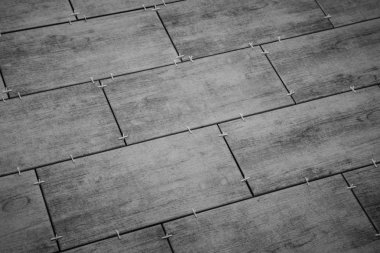 laying ceramic tiles on the floor. selected focus. background