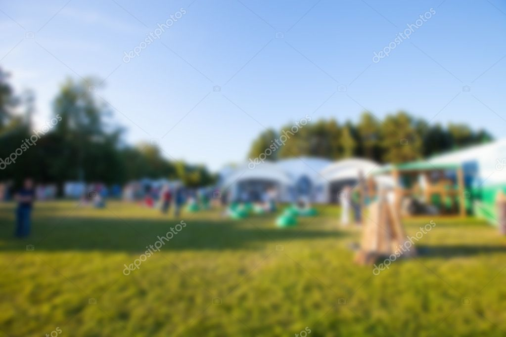 Abstract blur image, a holiday in the open air on a green lawn