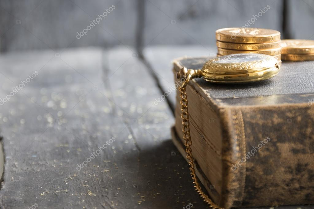business background with pocket watch, book and coins