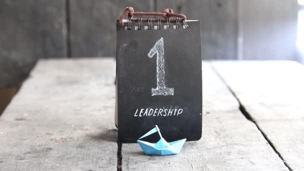 vedení - papír loď a číslo jedna