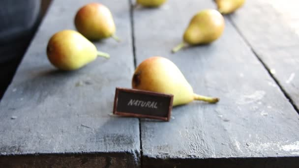 text natural and Juicy flavorful pears on a vintage table