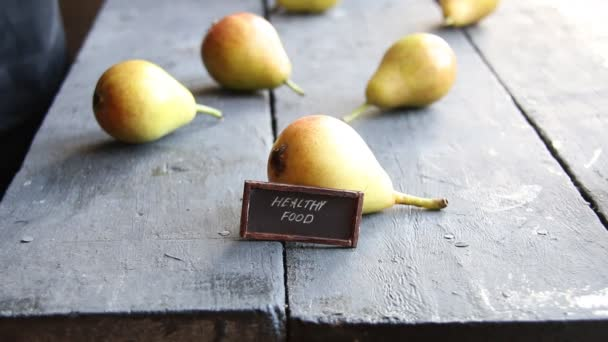 healthy food idea, inscription and Juicy flavorful pears, rustic style