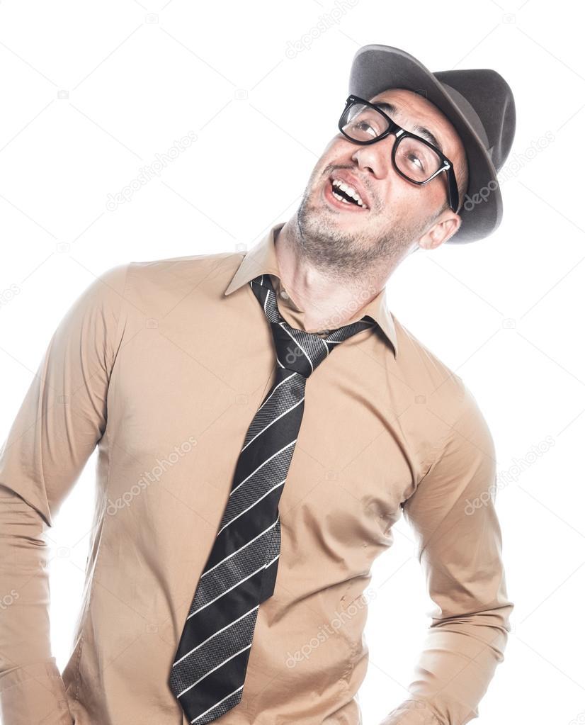 Riendo stylished retro americano joven - hombre de negocios con sombrero y  corbata 0b1c28f6f8a