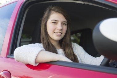 Teenage Girl Sitting In Car For Driving Lesson