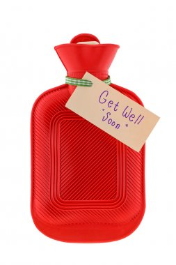 A red hot water bag with a paper written Get Well Soon