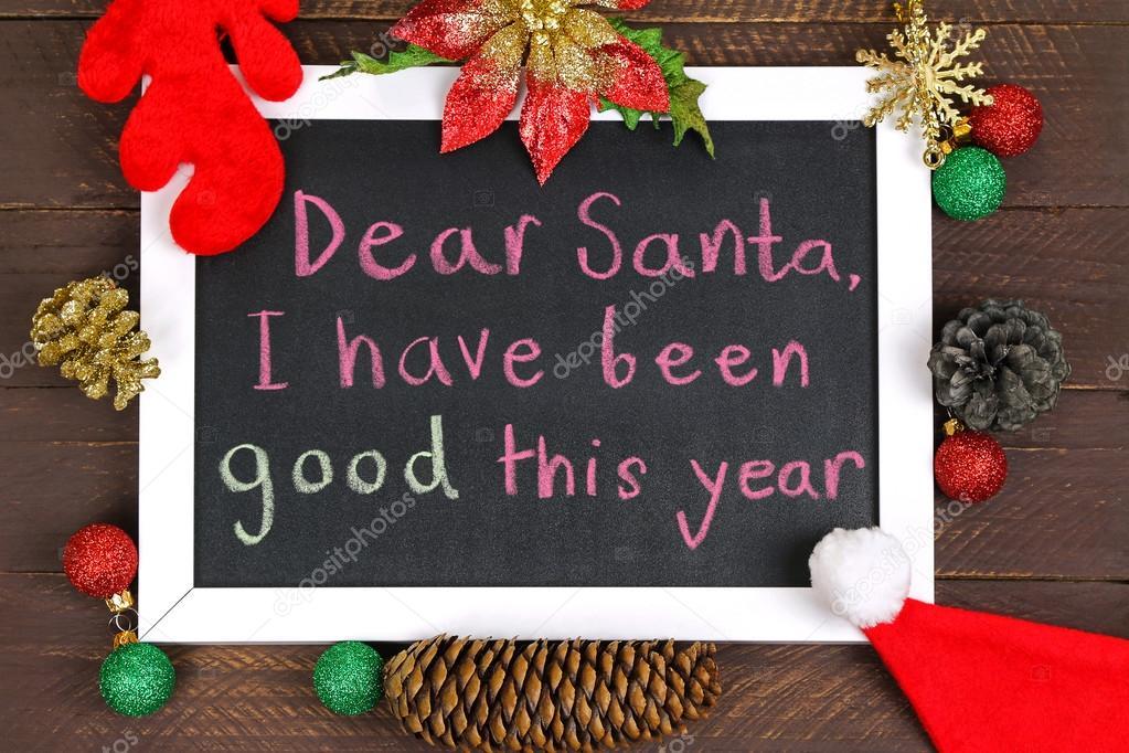 Una pizarra blanca enmarcada con un mensaje para Papá Noel con ...