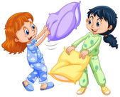 Two girls playing pillow fight at slumber party