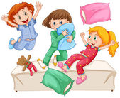 Three girls playing pillow fight at the slumber party