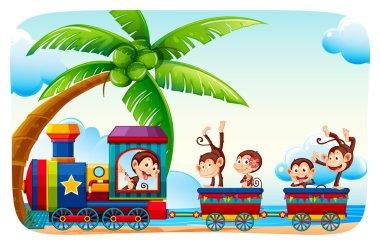 Monkeys sitting on a train at beach side