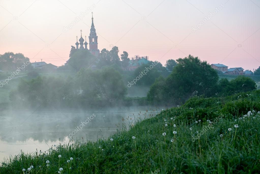 Фотообои Morning sunrise over village