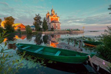 Wooden boat and church