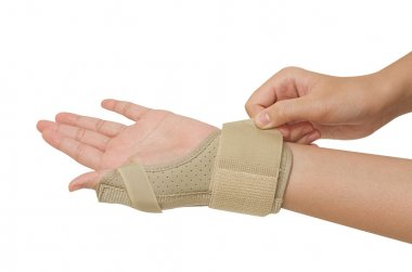 Sport injury, wrist with  brace support release pain
