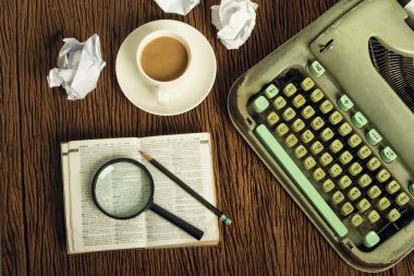 The dictionary consider under a magnifier on writer's desk with