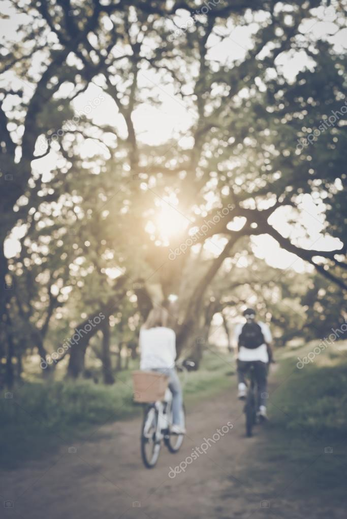 Blurred Young Couple Riding Bicycles
