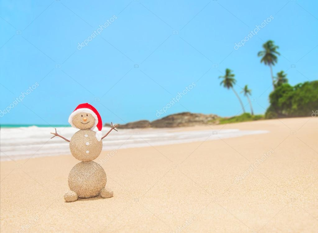 Christmas sandy snowman at  ocean beach