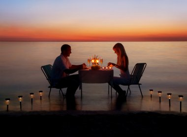 Couple share a romantic dinner