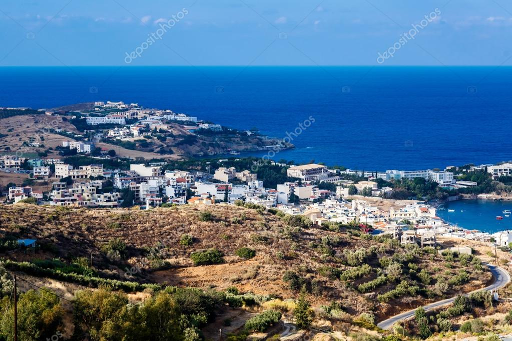 The top view on the sea and the city of Agia Pelagia in Crete, G