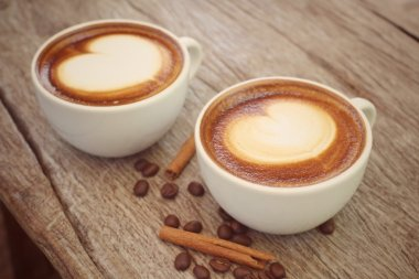 Two cups of latte art coffee