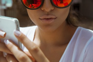 beautiful woman playing with her smart phone.