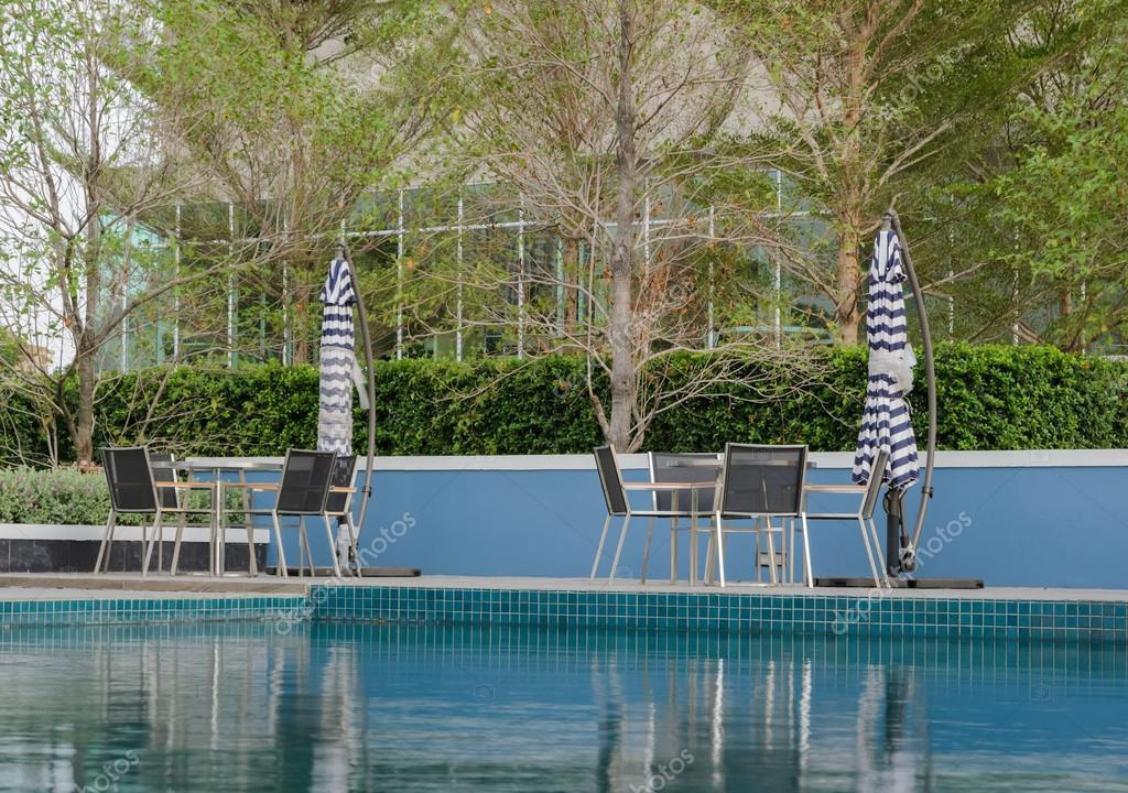 Poolside Table And Chairs U2014 Stock Photo