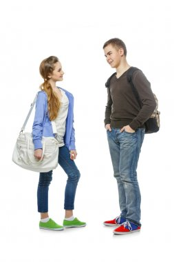 Teenage boy and girl isolated on white