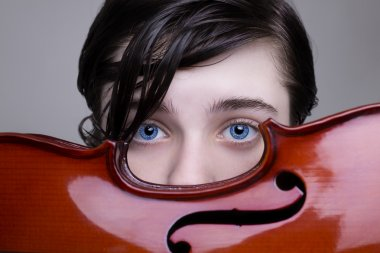 Beautiful blue-eyed boy holding a violin