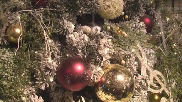 The fragment is decorated with a Christmas tree decorated with colored balls and garlands