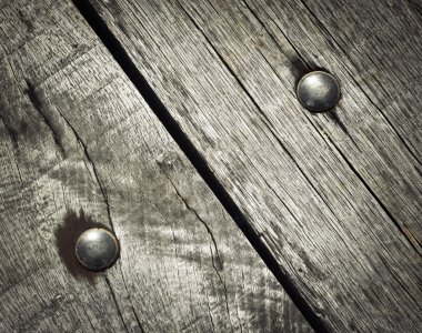 detail riveted on wooden boards