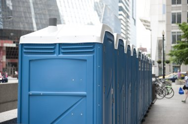 Public toilets of blue color on the streets