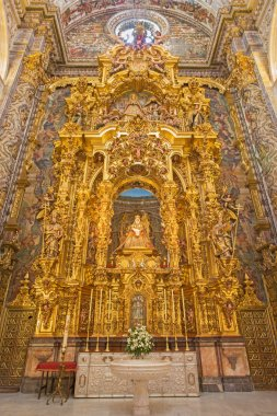 SEVILLE, SPAIN - OCTOBER 28, 2014: The side altar of Virgen de las Aqua completed in year 1731 by various artists in baroque Church of El Salvador (Iglesia del Salvador).