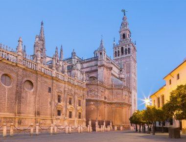 Seville - Cathedral de Santa Maria de la Sede with the Giralda bell tower in morning dusk.