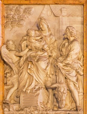 ROME, ITALY - MARCH 24, 2015: The marble relief of  Flight of Holy Family into Egypt in church Chiesa di Santa Maria della Vittoria by Etienne Monnot (1657 - 1733).