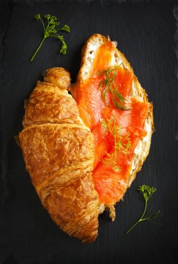 Croissant with salmon and cream cheese. Top view