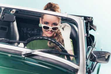 Vintage 1960 woman in convertible car