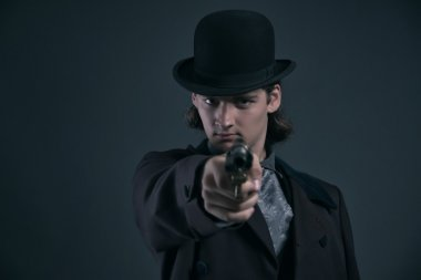 Shooting western 1900 fashion man with brown hair and hat. Studi