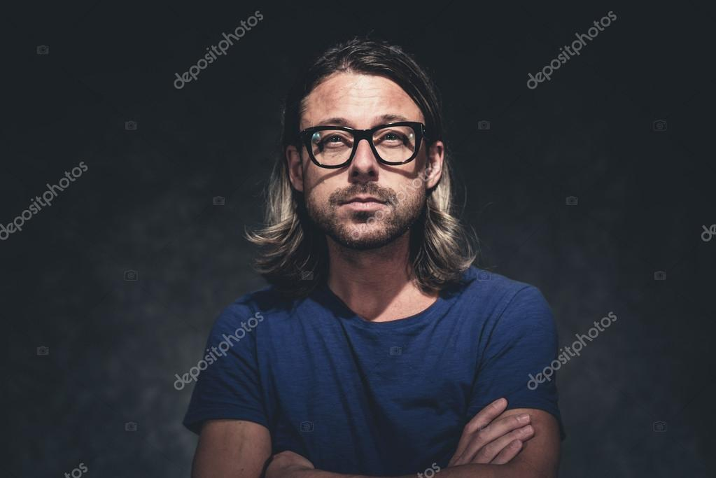 Authentic Studio Portrait Of Man With Long Blonde Hair And Retro