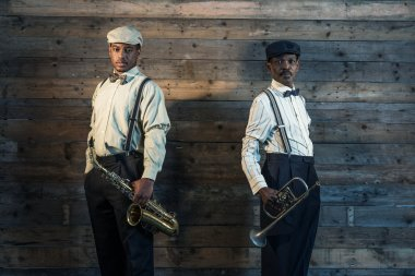 Two african american jazz musicians with trumpet and saxophone s