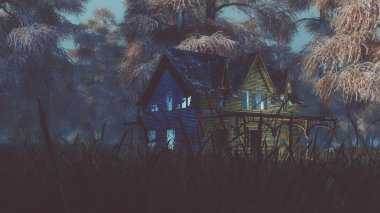 Abandoned house with lights on field in misty autumn forest at n