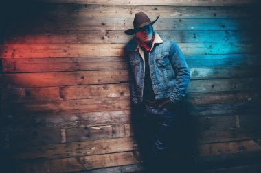 Winter cowboy jeans fashion man. Wearing brown hat, jeans jacket
