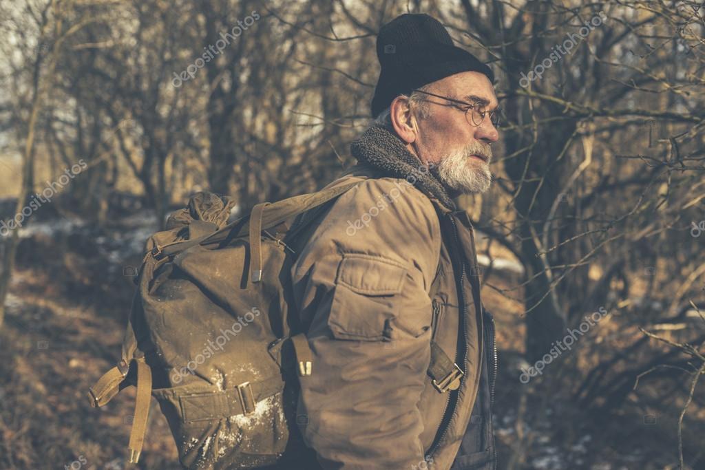 Senior man enjoying a wilderness hike