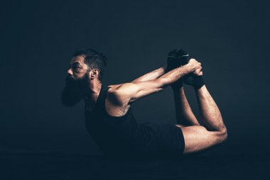 Man Doing Dhanurasana Bow Pose