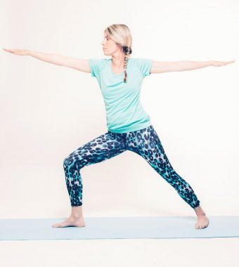 Woman Doing Warrior 1 Yoga Pose