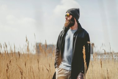 Man standing in a dry field