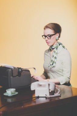 Blonde secretary woman sitting