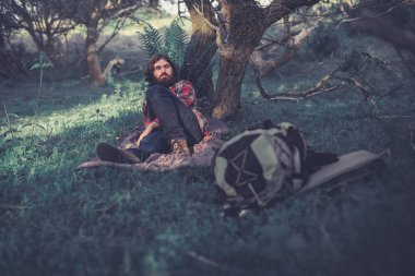 Backpacker relaxing in the shade of a tree