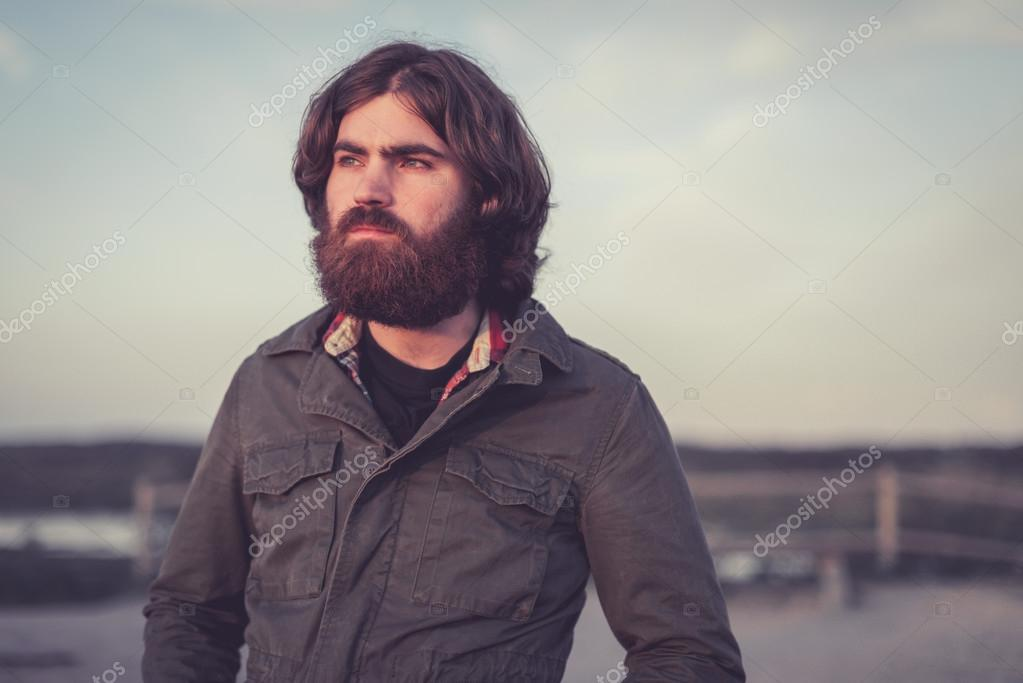 Handsome bearded man standing staring